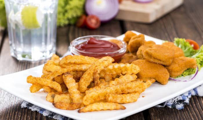 Portion of Chicken Nuggets with fries