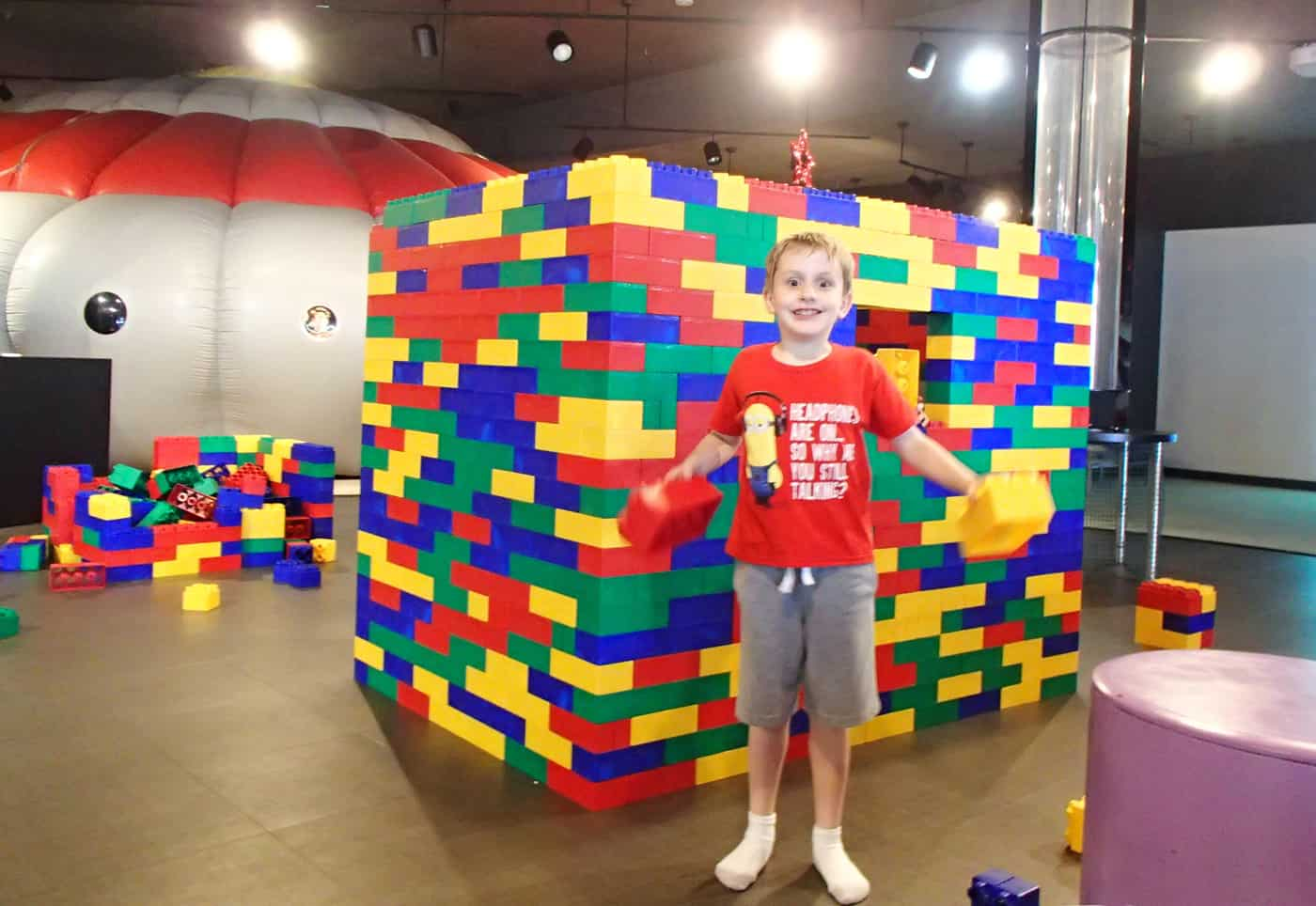 Myseum kid plays with giant legos