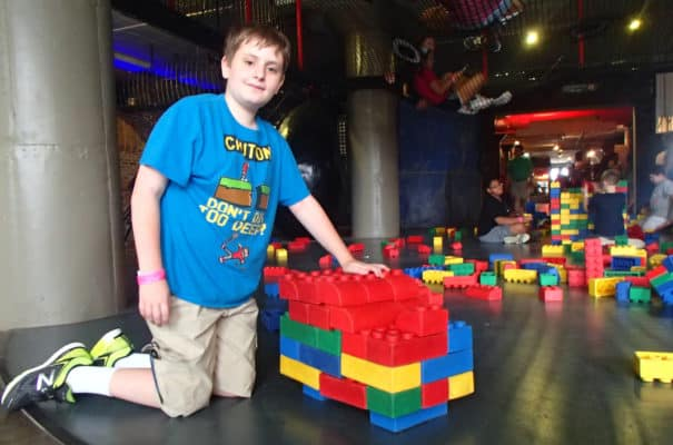 kid playing with giant LEGOs at the City Museum