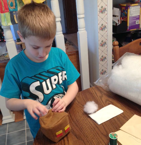 kid stuffing a Minecraft plush felt Magma cube
