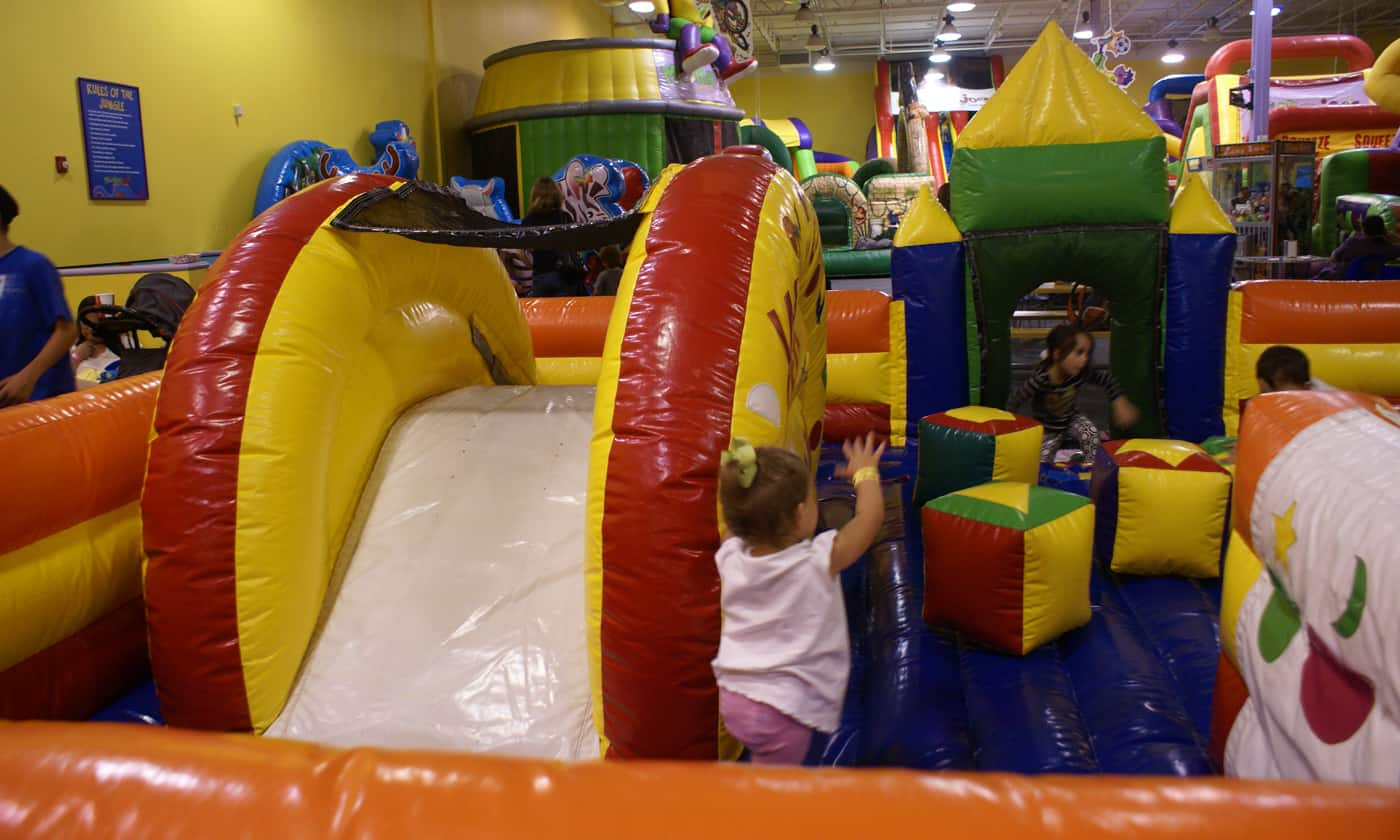 kids playing on inflatables at Monkey Joes indoor play