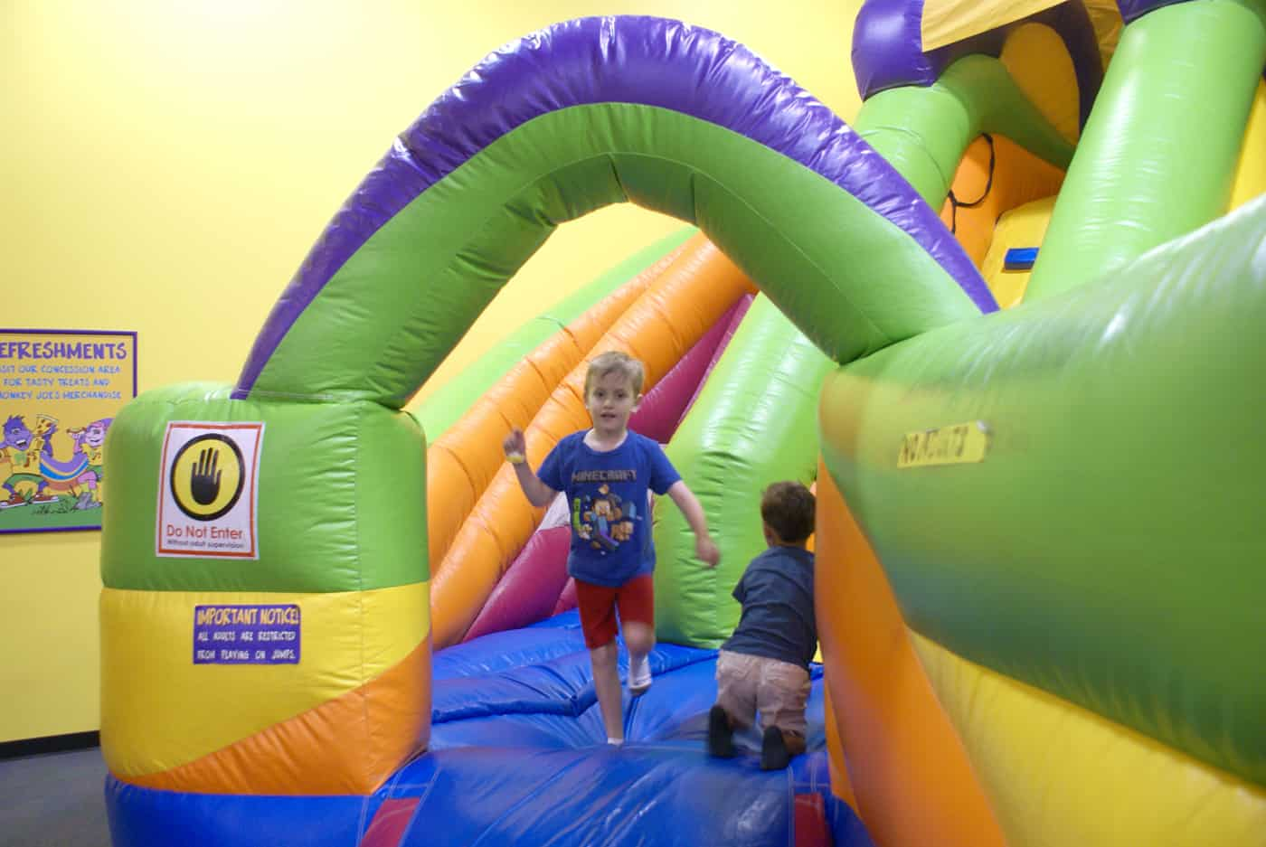 Kid on inflatable at Monkey Joes