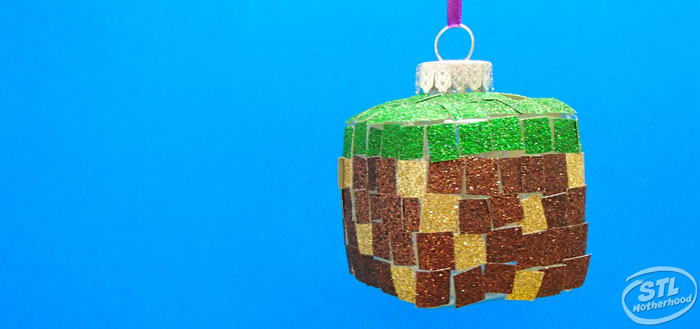 square ornament with green, gold and brown glitter stickers to look like a Minecraft grass block