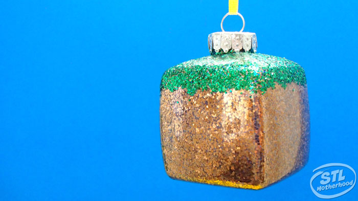 square ornament with Green and gold glitter to look like Minecraft grass block
