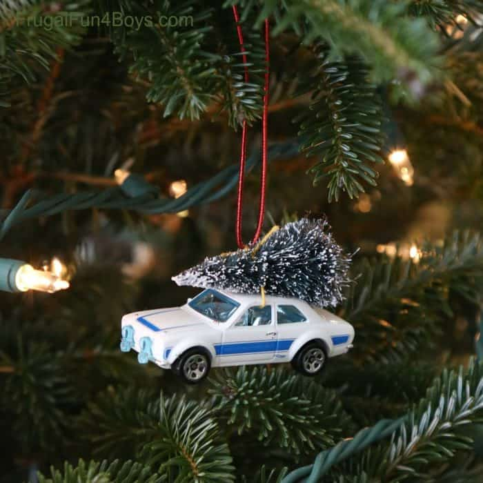 bringing home the Christmas tree ornament with a Hot Wheel