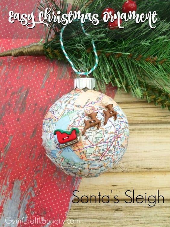 Christmas ornament with map paper and Santa sleigh