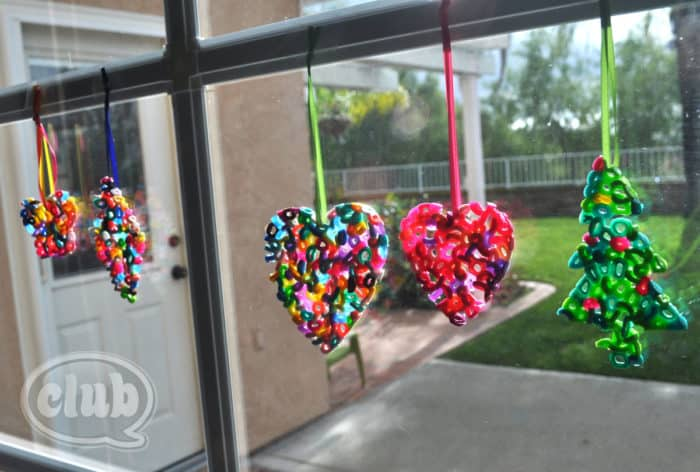 colorful melted bead ornaments hanging in window