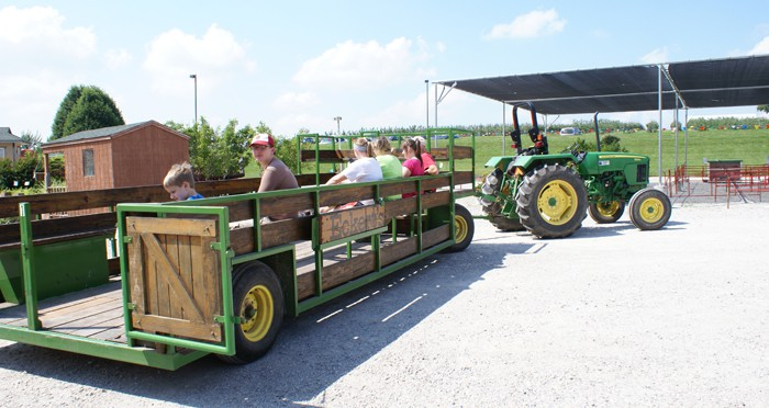 Eckert's farm wagon loaded with visitors to take to the field.