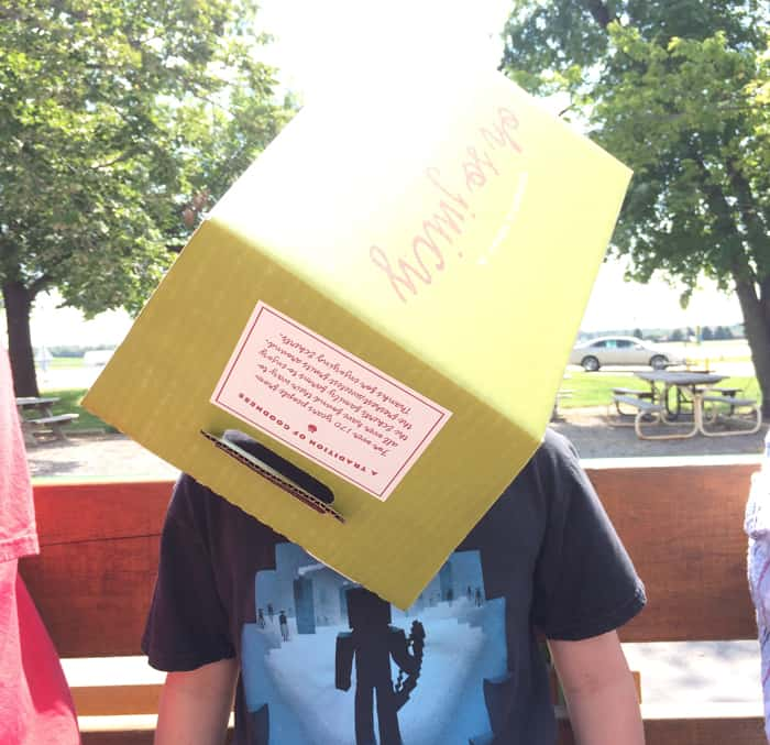 Boy wears an Eckert's Farm box on his head