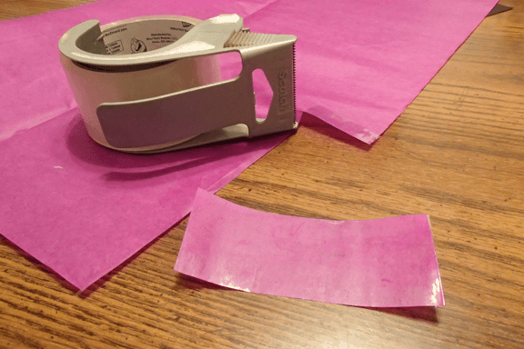 purple paper is waterproofed with packing tape