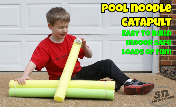 kid in red shirt with pool noodle catapult
