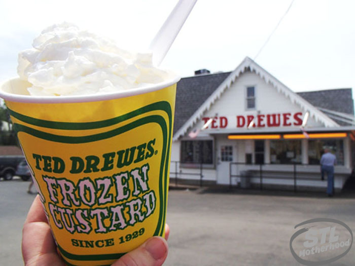 Ted Drewes frozen custard in a yellow cup, building in the background