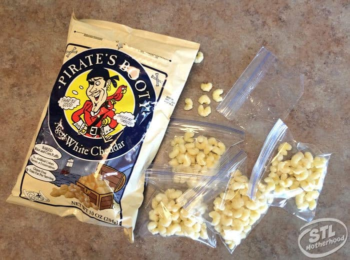Pirates Booty snacks packed into ziplock bags sitting next to the bag