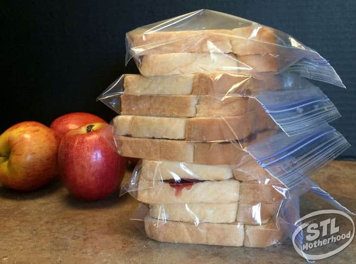 peanut butter and jelly sandwiches, stacked and frozen.