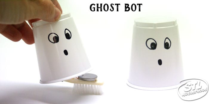 Halloween ghost bot --brush bot inside a white plastic cup with a ghost face drawn on