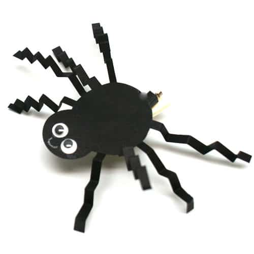 Halloween Brush Bot decorated with a paper spider and happy face.