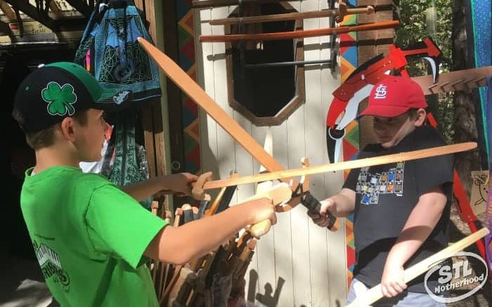St. Louis Renaissance festival: kids trying out wooden swords