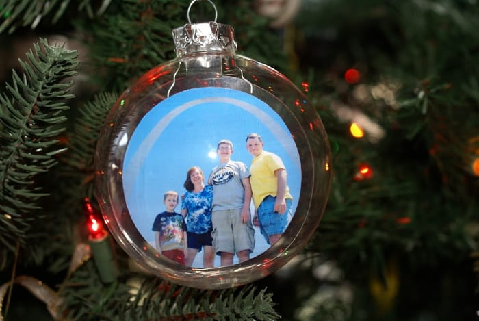 plastic ornament with family photo floating inside