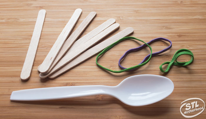 supplies for a popsicle stick catapult--sticks, rubber bands and a plastic spoon
