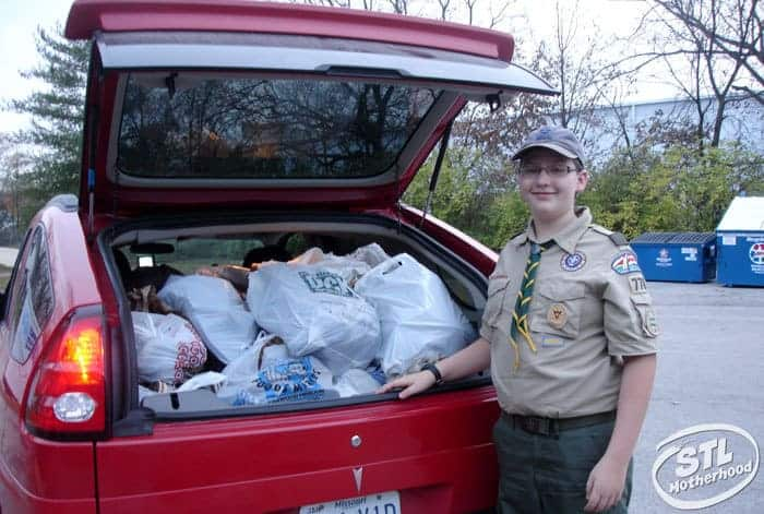 boy scout with car full of donations to Goodwill