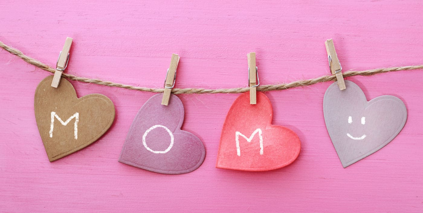 paper hearts on a string, spells out mom