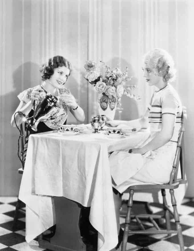 Two women having tea together