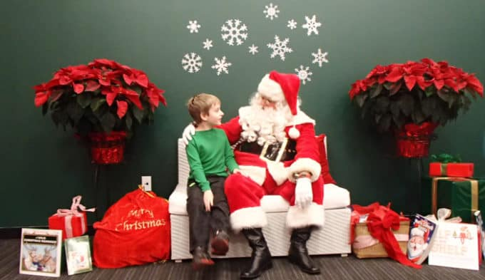 boy talks to santa