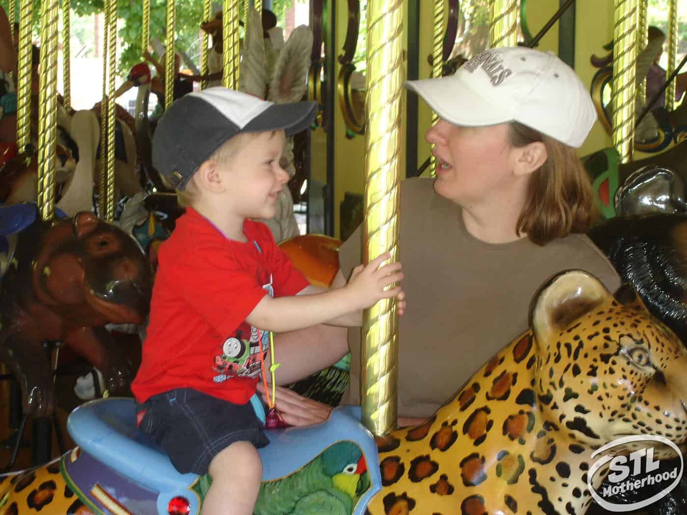 Mother and son on the Conservation Carousel at the St. Louis Zoo