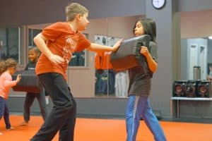 kid learning krav maga at xtreme krav maga midtown St. Louis