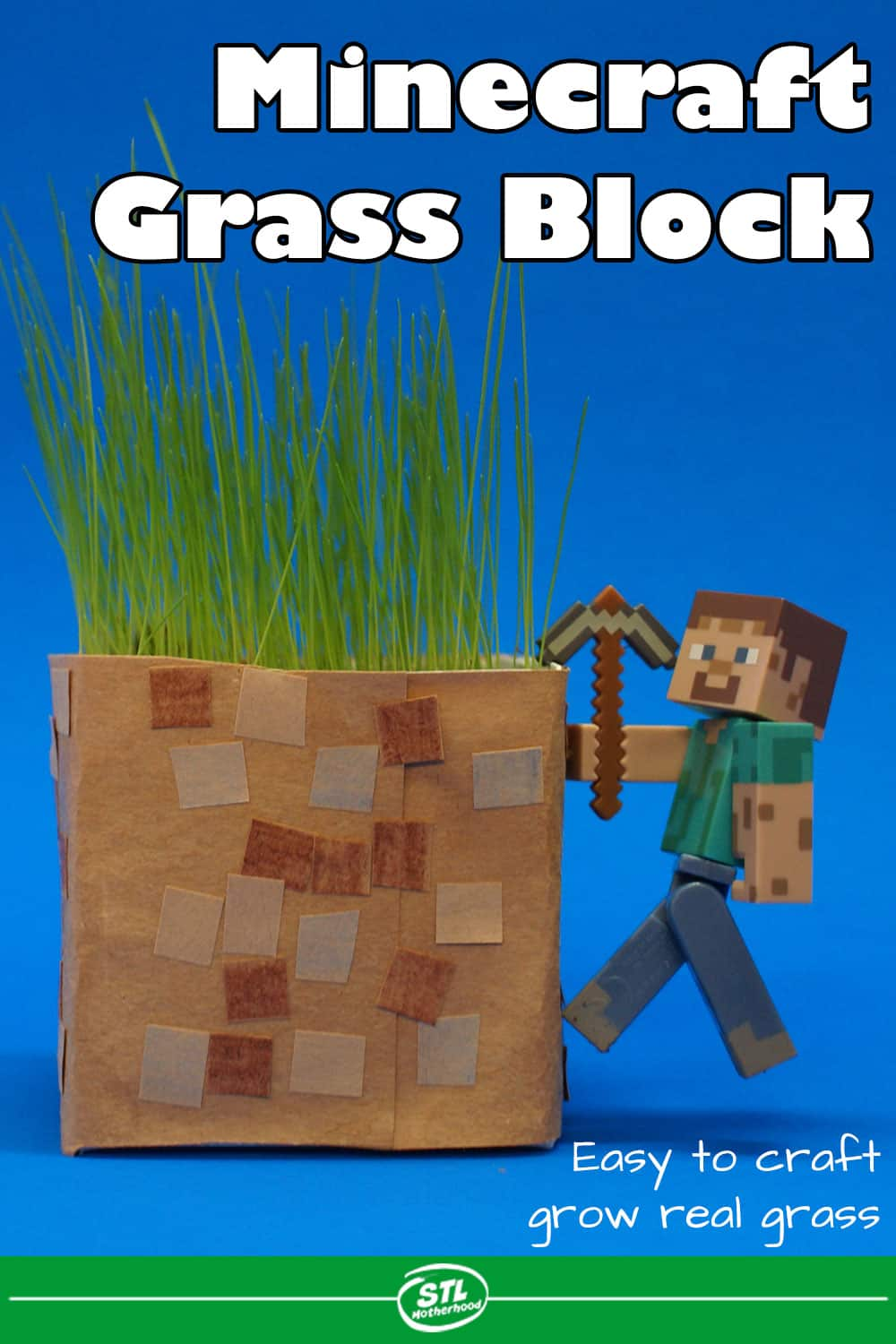 Minecraft block made from a dairy carton and decorated with paper, planted with grass.