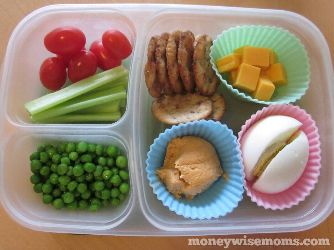 disposable food container with silicone cups holding portions of lunch, bento style