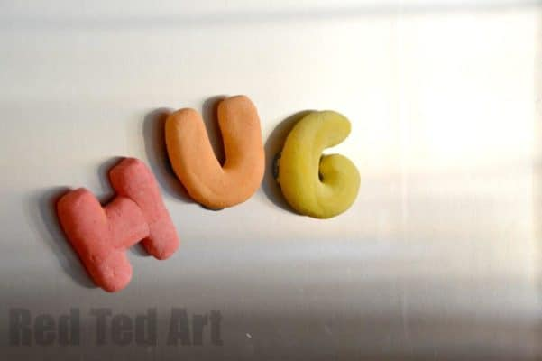 The word HUG spelled out in salt dough shapes