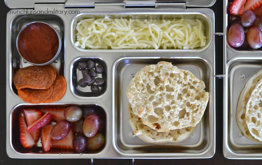 Metal bento box with lunch: ingredients for a pizza