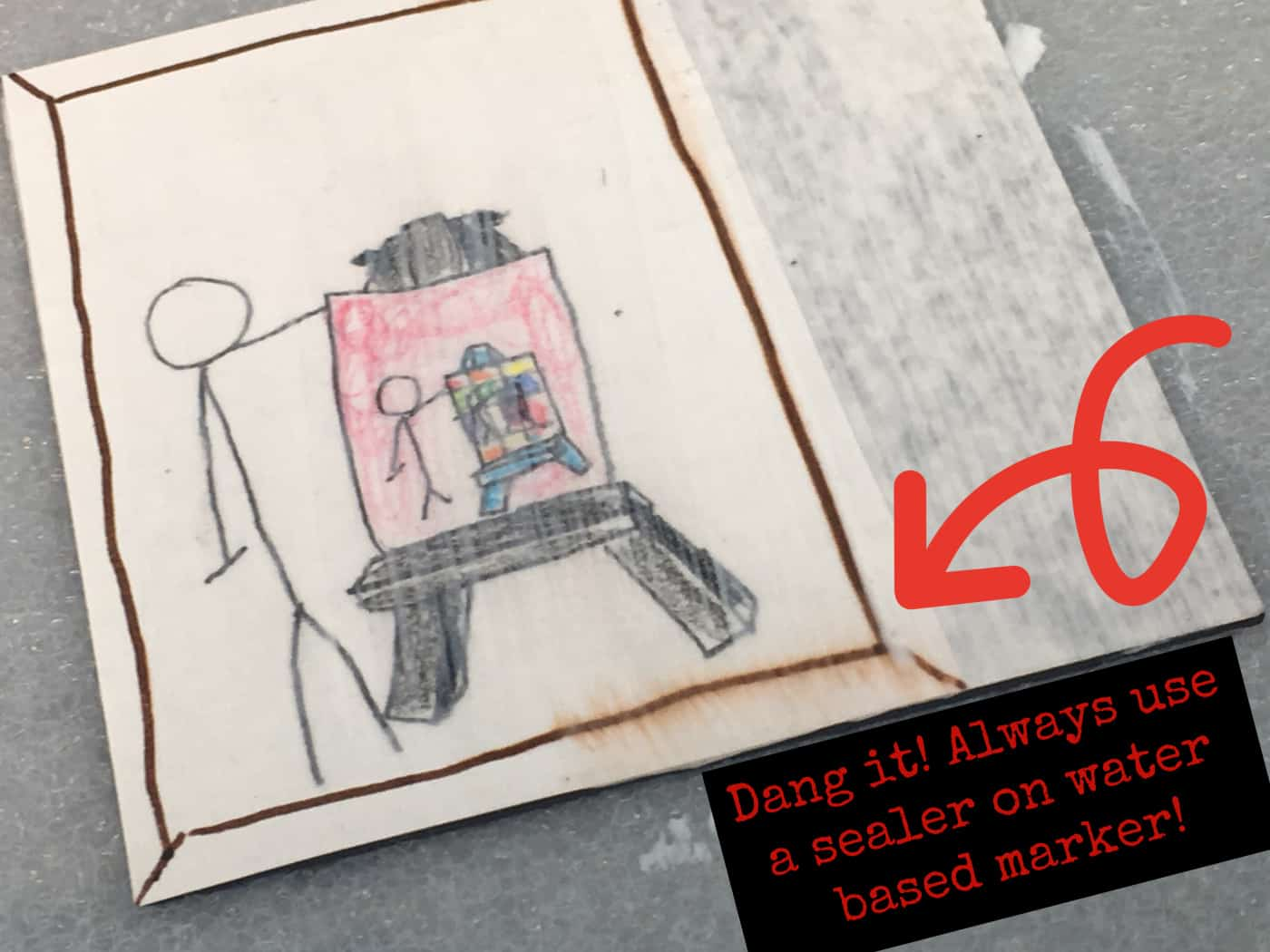 Kid drawing made with markers that smeared when Mod Podge was applied