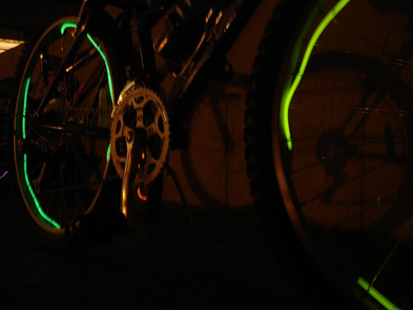 glow stick necklace wrapped around the spokes of a bike