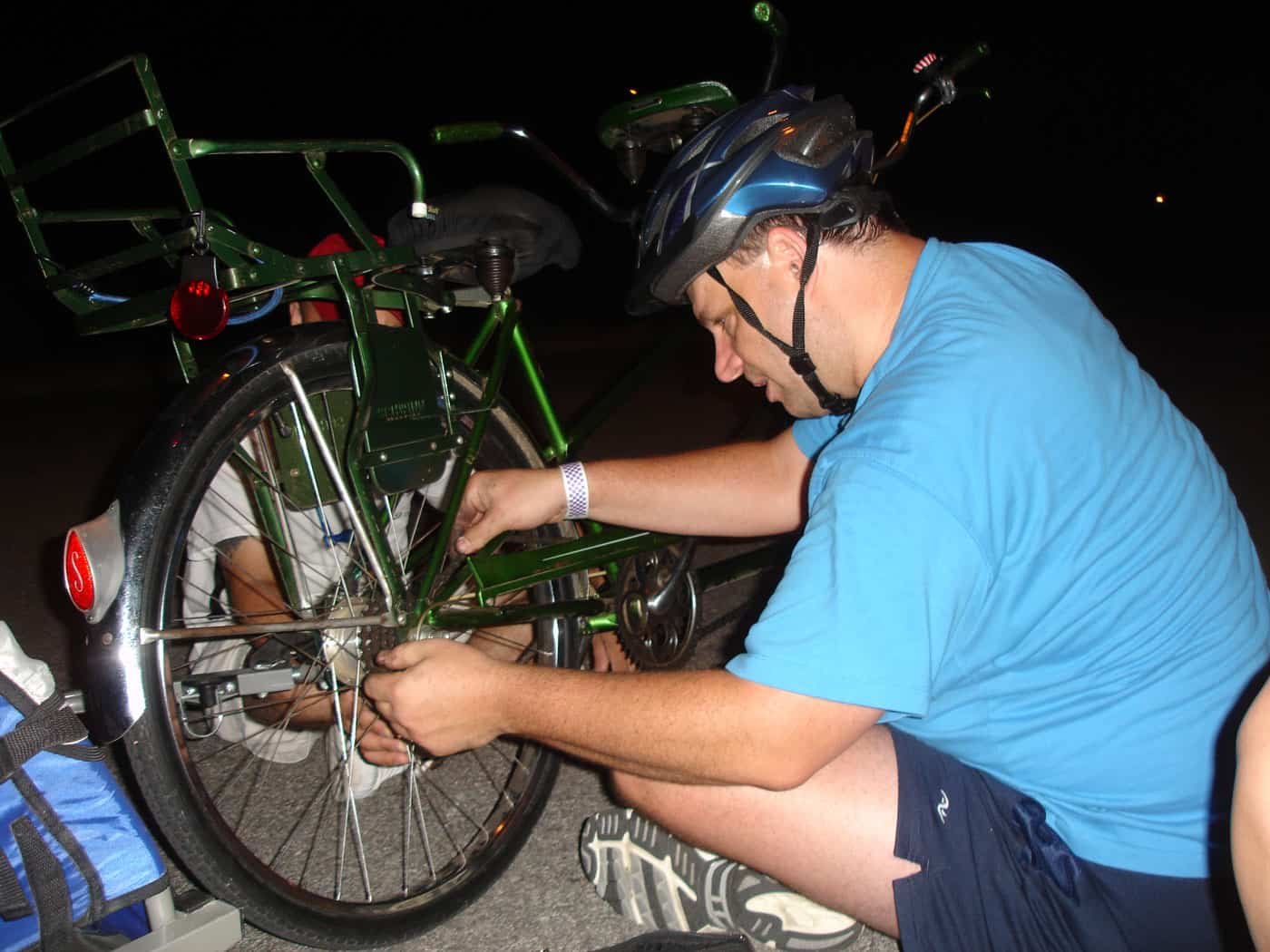 Man fixing tandem bike