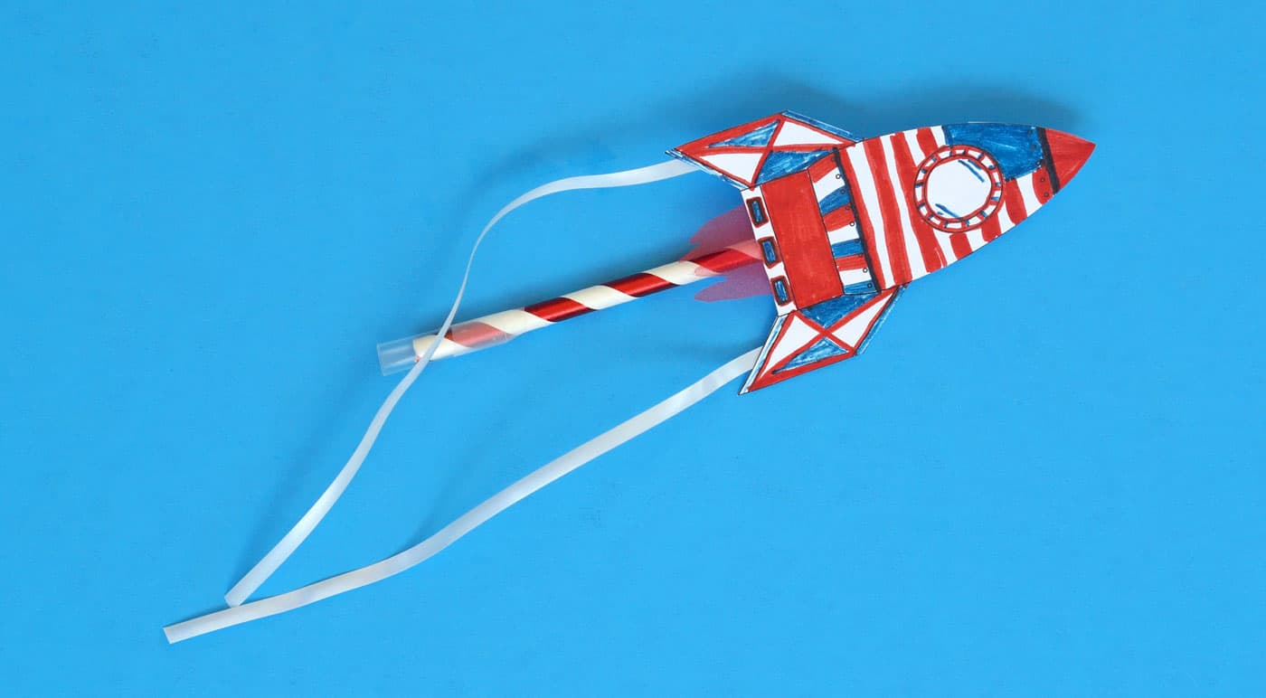 4th of July paper rocket on a straw, red white and blue