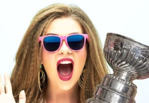 woman in 80's sunglasses with Stanley hockey champion cup