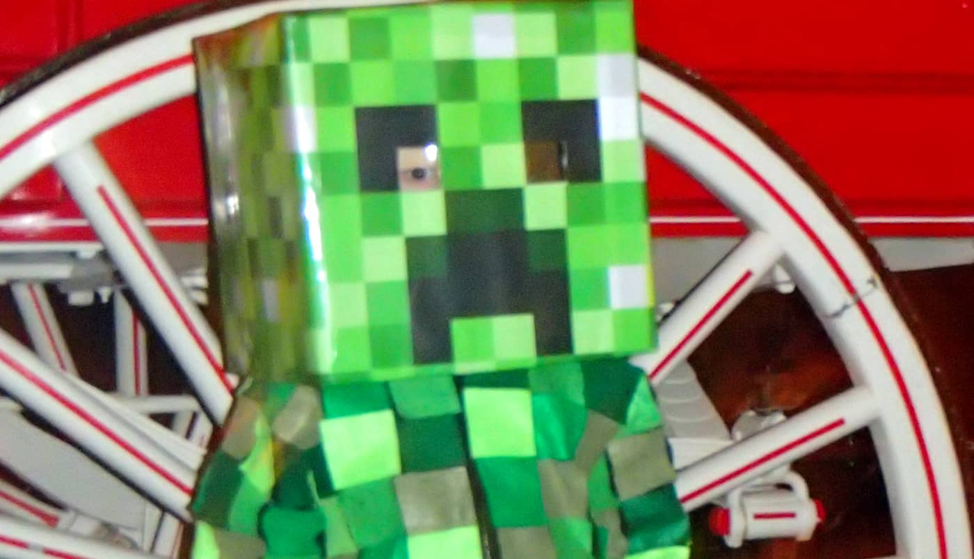 Kid in Minecraft Creeper costume, close up on head