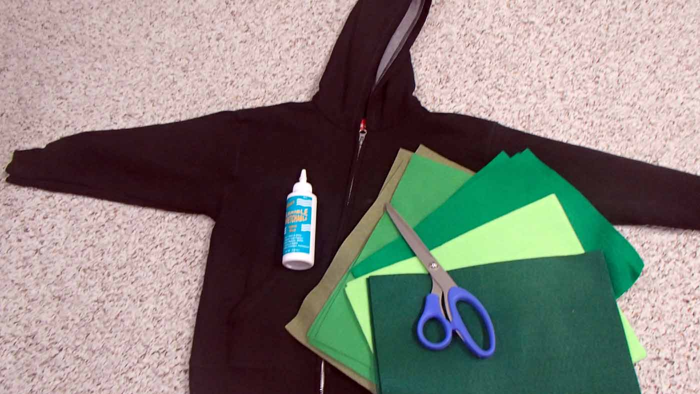 black hoodie and green felt squares