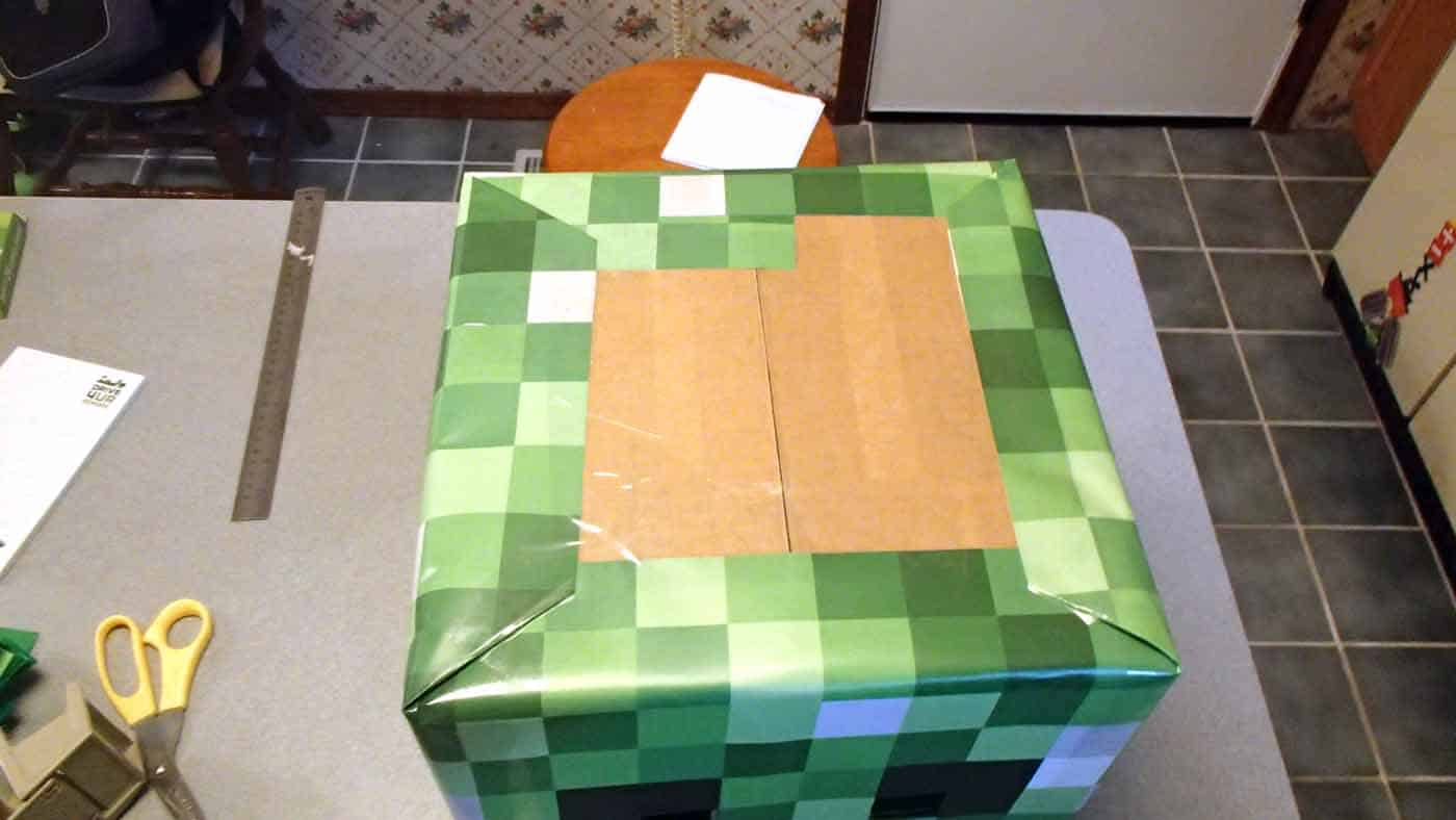 folding patterned paper around box