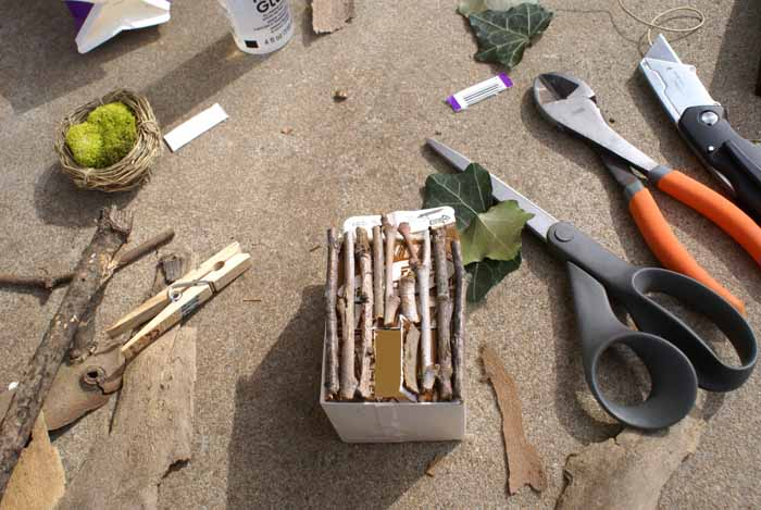 sticks on a dairy carton to build a fairy house