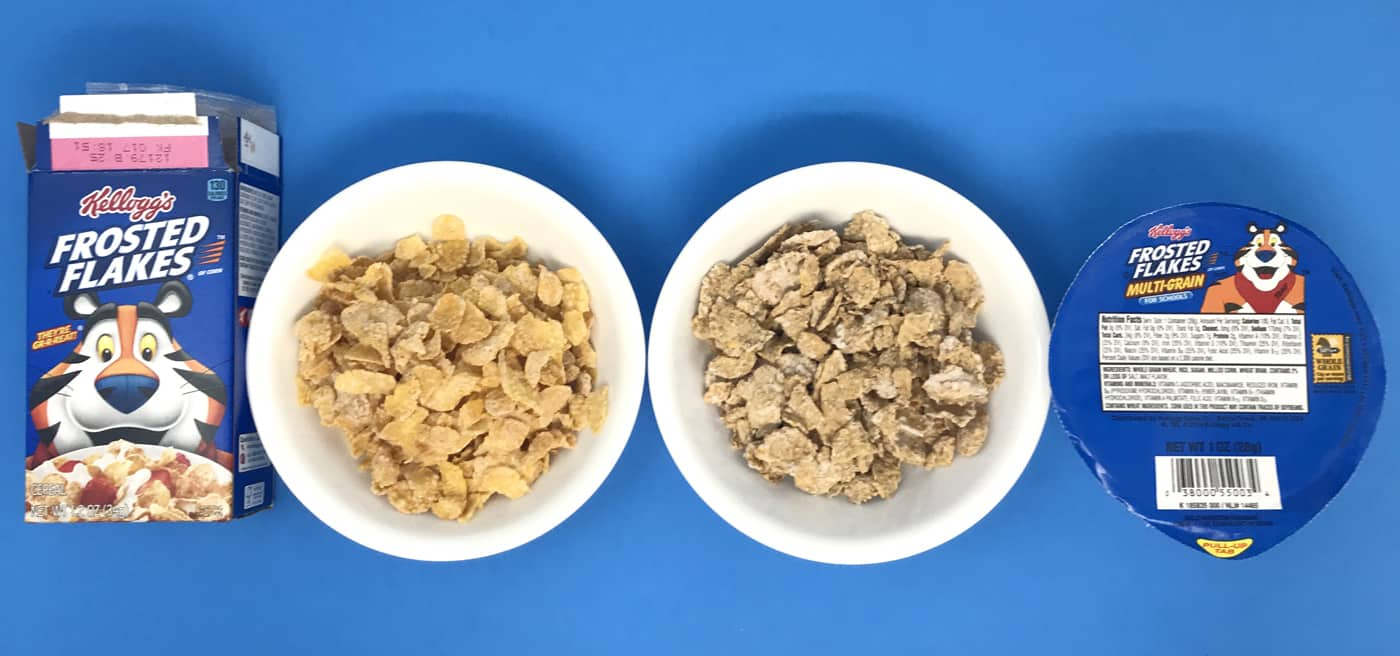 Two bowls of Frosted Flakes, one is whole grain for schools.