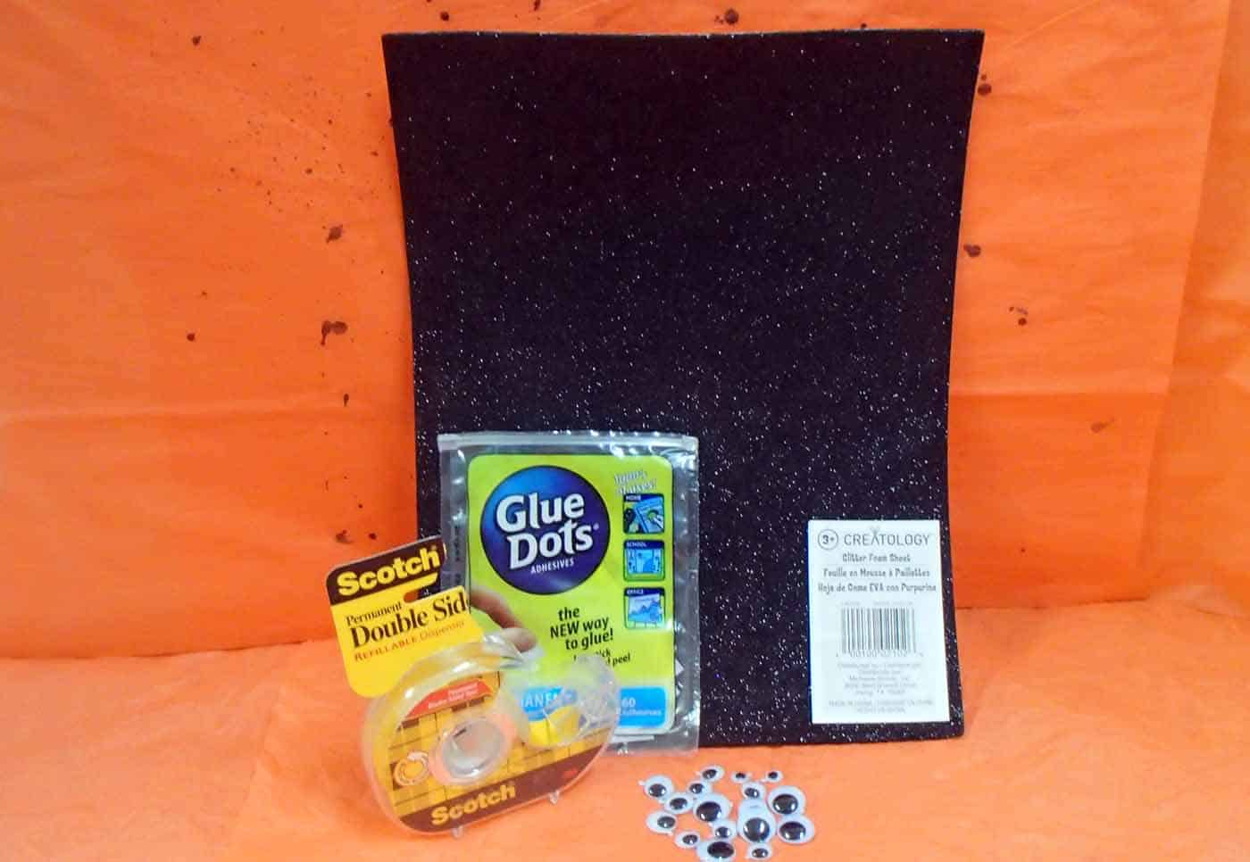 supplies for no carve pumpkin: black glitter foam, black paper, glue dots, double stick tape, googly eyes
