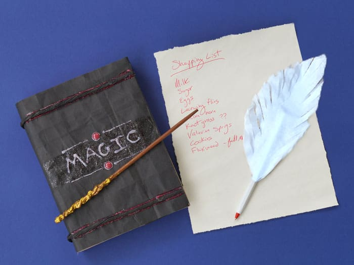 quill pen and a magic spell book and a grocery list