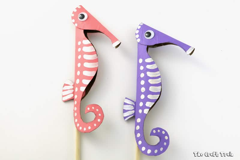 cardboard seahorses in pink and purple
