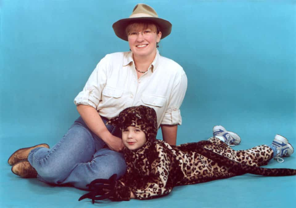 Mom and kid Halloween costume: kid in a spotted Jaguar costume, mom dressed as zoo keeper