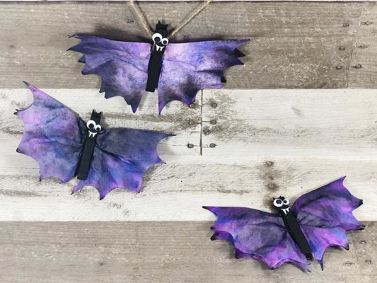 Purple and black bats made from coffee filters and clothes pins