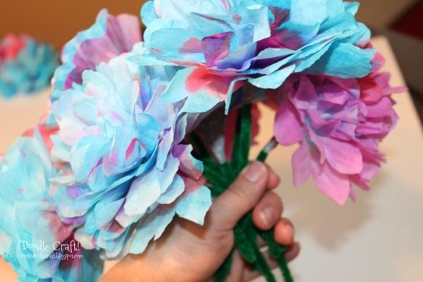 bundle of flowers made from blue and purple coffee filters