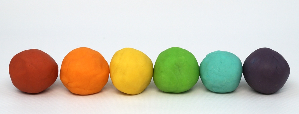 balls of home made play dough in rainbow colors